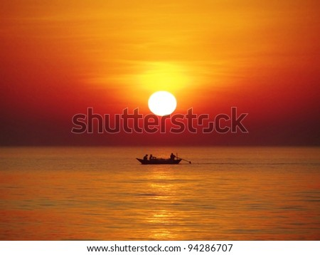 Sunset with Fishing boat - stock photo