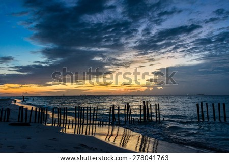 Sunset with people swimming at Caribbean Island. Mexico, Cancun. - stock photo