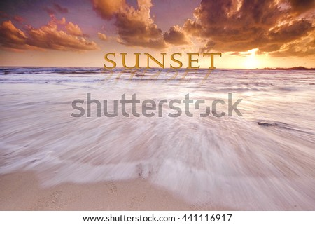 SUNSET  word in dramatic sunset at clean beach with slow shutter lanscape, seascape  - stock photo