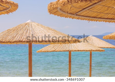 Sunshade and Chairs on the Sandy Tropical Beach, Summer travel destination - stock photo
