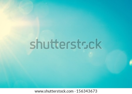 Sunshine and blue sky with flares in summer - stock photo