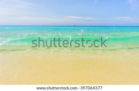 Sunshine sky and sea wave at Karon beach, Phuket, Thailand. Summer sea beach with waves, blue sunny sky and white sand. Sunshine on sea wave. Sea waves near beach. Tropical sea beach. Sea wave, Phuket - stock photo