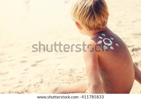 Suntan Child Caucasian Shoulder Sign Wave Sun Sea Apply Cream Sun Light Sunny Day Gentle Skin Cosmetic Easy Travel Selective Focus Toned  - stock photo