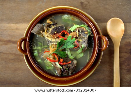 Sup Tulang - is the Malaysian version of bone broths. It is a traditional recipe, a humble but nutritious broth eaten for generations as comfort food. garnish with cili, lime and vegetables - stock photo