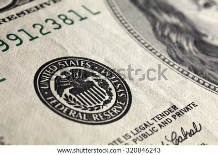 Super close up macro image of American one hundred dollar bill, focus on the seal - stock photo