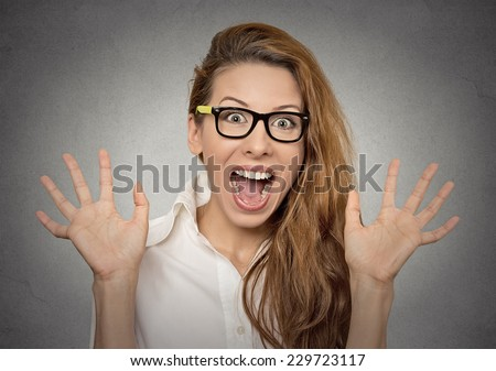 super excited funky young girl looking thrilled very happy isolated on grey wall background - stock photo