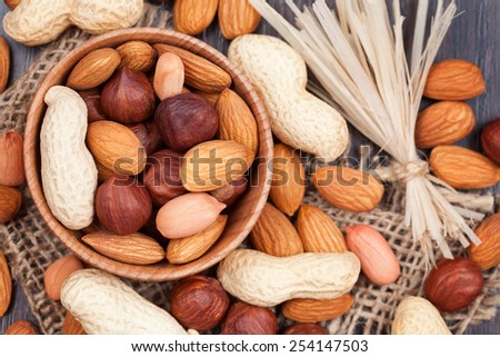 Super food different nuts mix on vintage textile background - stock photo