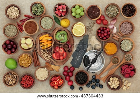 Super food selection for cold and flu remedy to boost immune system with acupuncture needles and moxa sticks. High in antioxidants, vitamins and minerals. - stock photo