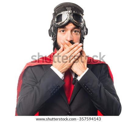 Super hero businessman covering his mouth - stock photo