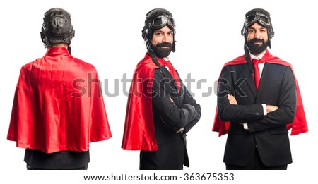 Super hero businessman with his arms crossed - stock photo