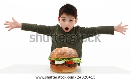 Super huge giant burger and a hungry boy. - stock photo