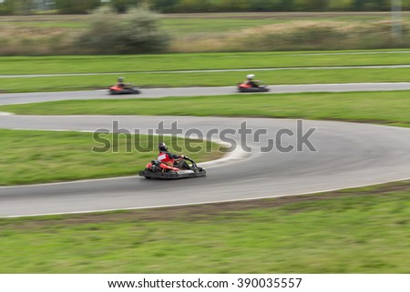 Super kart racing team. The racer on carting. Three Races on cartings. Races on a cross-country terrain. Cars races. Races on long exposure.  - stock photo