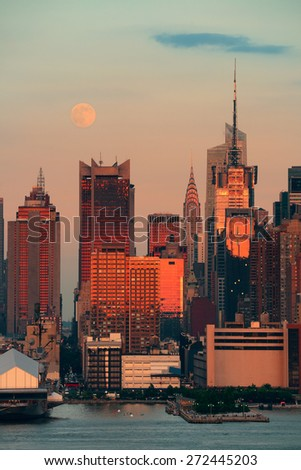Super Moon over Midtown Manhattan at sunset - stock photo