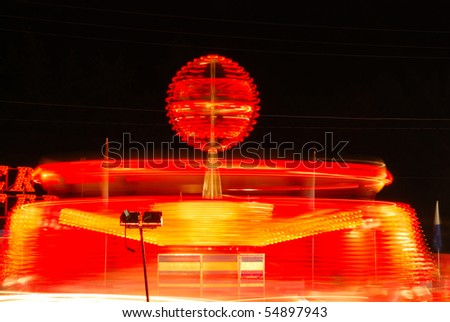 Super Orbitor ride as part of the midway at the 2009 Douglas County Fair in Roseburg Oregon at night. - stock photo
