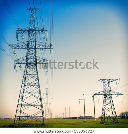 Super wide angle photograph of a row of power lines against a blue sky. Vintage - stock photo