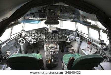 Superannuated airplane cockpit view - stock photo