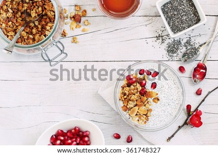 Superfoods concept : overnight chia pudding with homemade granola,pomegranate  and honey. Healthy eating. Selective focus. - stock photo