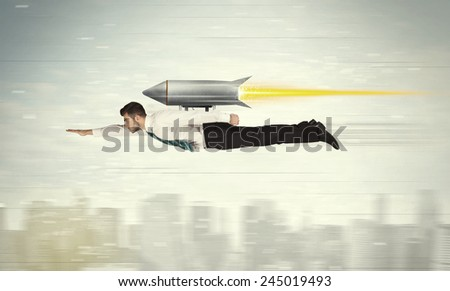 Superhero business man flying with jet pack rocket above the city concept - stock photo