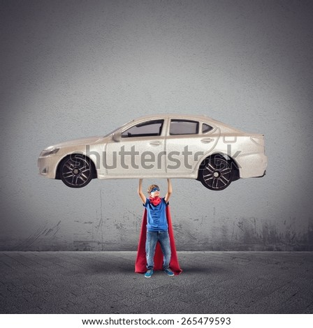 Superhero can lift a car with powers - stock photo