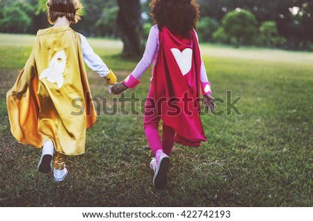 Superhero Girls Friendship Cute Happiness Fun Playful Concept - stock photo