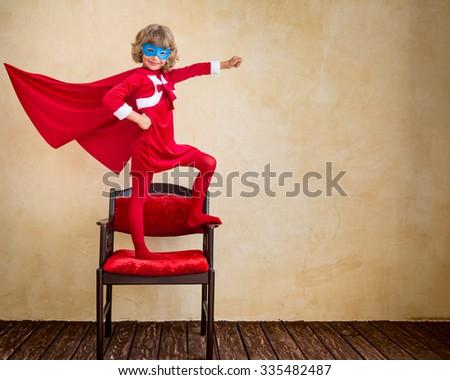 Superhero kid at home. Christmas holiday concept - stock photo