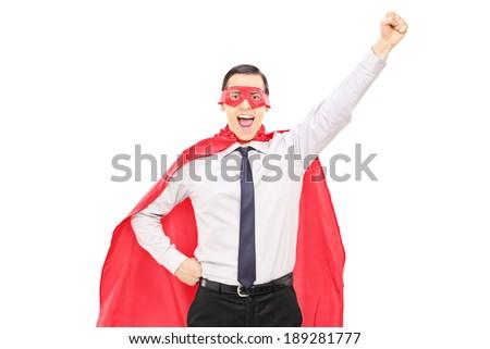 Superhero with raised fist isolated on white background - stock photo