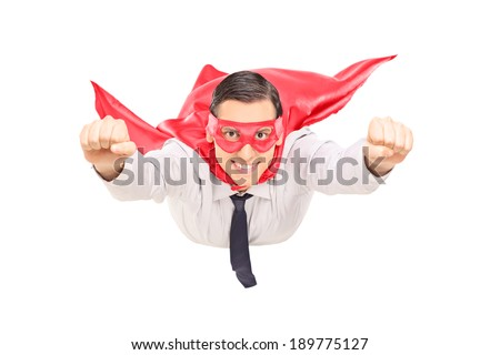 Superhero with red cape flying isolated on white background - stock photo