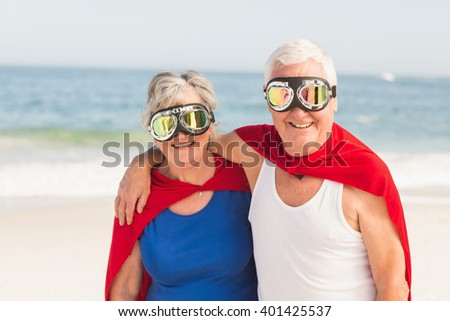 Superman couple wearing superman costume on a sunny day - stock photo