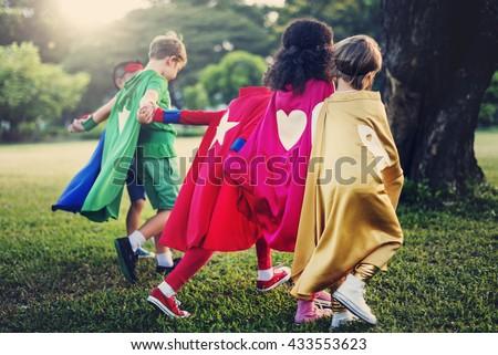 Superman Kid Playing Fun Cheerful Concept - stock photo