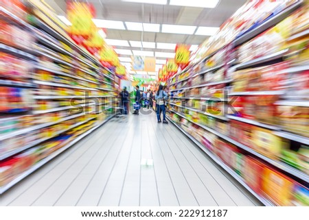 supermarket aisle,motion blur - stock photo