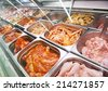 supermarket showcase or glass case of meat in souse - stock photo