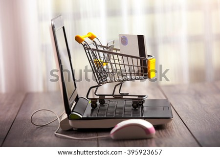 Supermarket trolleys filled with credit card - stock photo