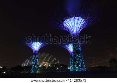 Supertree grove and conservatory at night in Gardens by the Bay, Singapore - stock photo