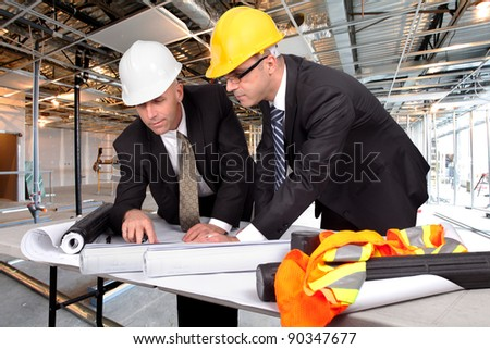 supervisors, managing a construction site - stock photo