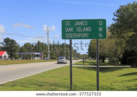 Supply, NC, USA - September 29, 2015: Road sign along 211 or Southport Supply Rd SE east towards St. James, Oak Island and Southport. Road sign in Supply, NC. - stock photo