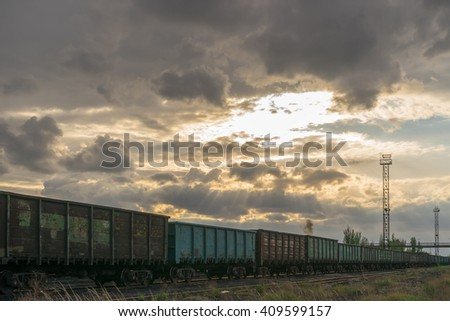 Supply of fuel for coal power plant. Scenic view of industrial sunset - stock photo