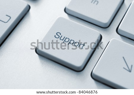 Support button on the keyboard. Toned Image. - stock photo