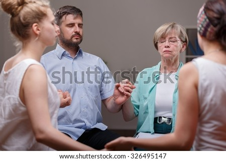 Support group sitting in a circle during therapy - stock photo