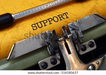 Support on typewriter - stock photo