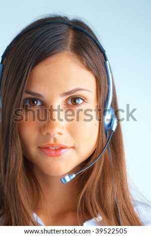 Support phone operator in headset on light blue background - stock photo