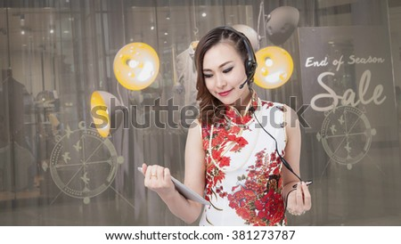 Support phone operator in headset. using digital tablet computer PC happy shopping mall background. Beautiful mixed race Asian with talk sale product. / Caucasian woman. on shopping mall or shop.  - stock photo