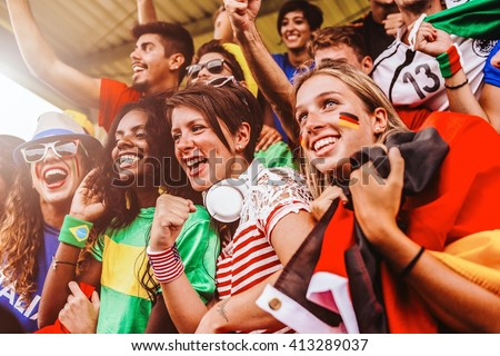 Supporters from Multiple Countries at Stadium All Together - stock photo