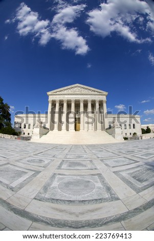 Supreme Court of the United States in Washington D,C. Blue sky behind and white clouds. Fisheye photo. - stock photo