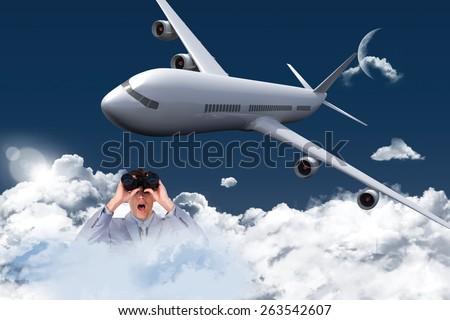 Suprised businessman looking through binoculars against night sky - stock photo