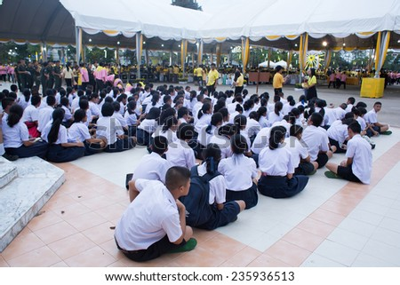 SURATTHANI, THAILAND - DEC 5: Unidentified students in the celebration of the 87th birthday of Thai King Bhumibol on December 5, 2014 in Suratthani, Thailand. King Bhumibol is respected by most Thais. - stock photo