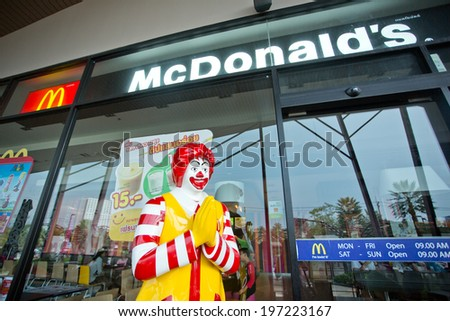 SURATTHANI, THAILAND - JUNE 7: Exterior view and mascot of a McDonald's Restaurant on June 7, 2014 in Suratthani, Thailand. It is the world's largest chain of hamburger fast food restaurants. - stock photo