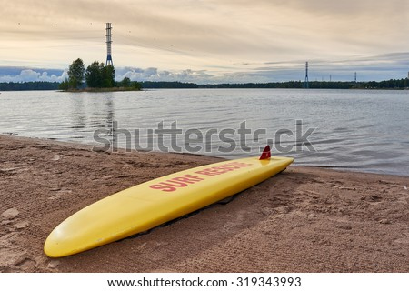 Surf Board  in beach on a summer evening. - stock photo
