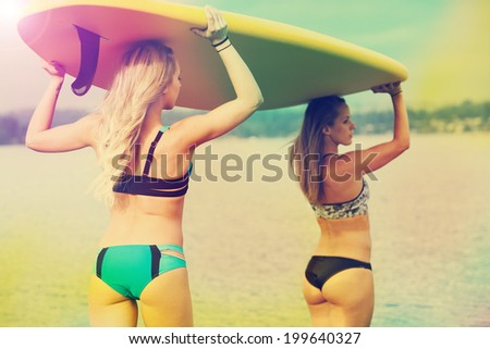 Surf board or Stand up paddleboard women - stock photo