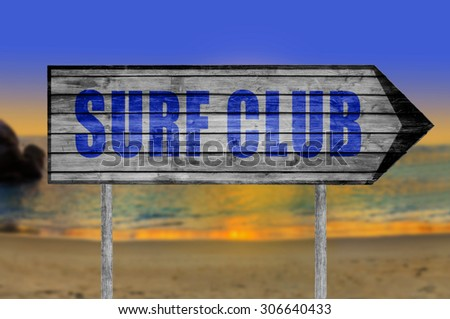 Surf Club wooden sign with on a beach background - stock photo