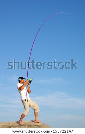Surf fishing. Fish fight - stock photo